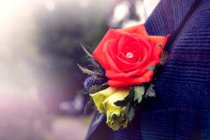 Close-up off orange rose wedding buttonhole