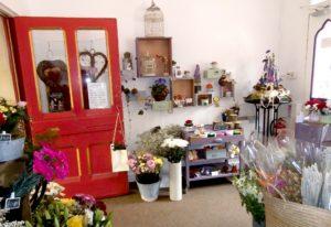 Inside view of Shrinking Violet Bespoke Floristry at Great Malvern Station showing shop and floral displays