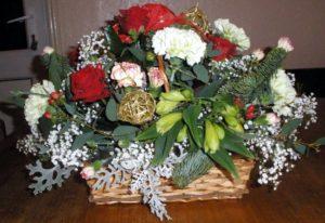 Red rose festive basket by Shrinking Violet Bespoke Floristry