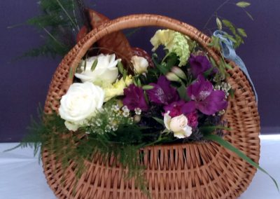 Floral basket with white and purple flowers