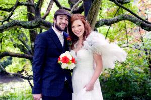 Gordon and Armi on their wedding day holding flowrs by Shrinking Violet