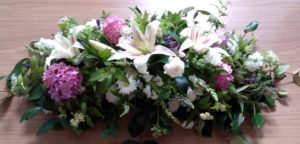 Simple pinks funeral flowers by Shrinking Violet