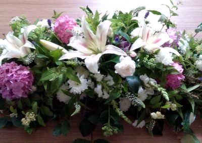 Simple pinks funeral flowers