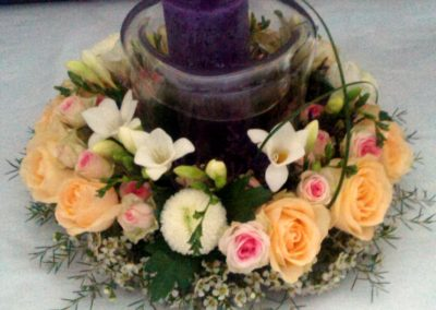 Peach and pink rose candle display