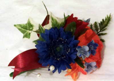 Red and blue wedding buttonhole