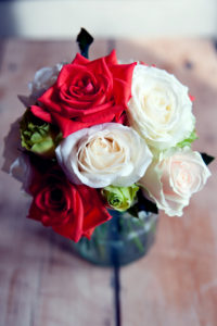 Red and white rose bespoke wedding flowers by Shrinking Violet