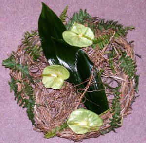 Beautiful minimalistic wreath using just green and brown foliage.