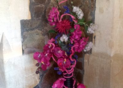 Tall shocking pink in vase