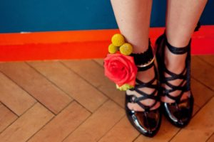 Red and yellow wedding anklet with black strappy shoes