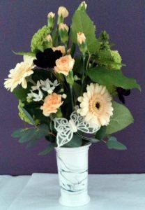 Peach vase display by Shrinking Violet