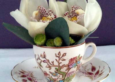 Orchid teacup display by Shrinking Violet