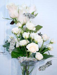 Stunning white vase display by Shrinking Violet
