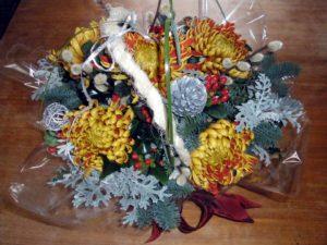 Bright festive centrepiece by Shrinking Violet Bespoke Floristry
