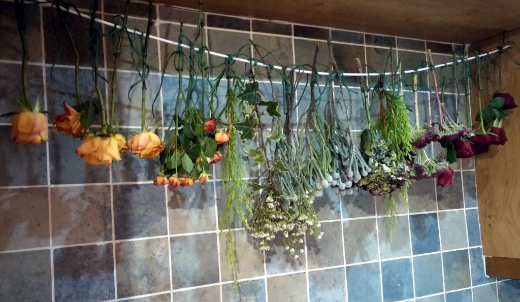 Preserve flowers by air drying as shown with these hanging wedding flowers from shrinking violet bespoke floristry